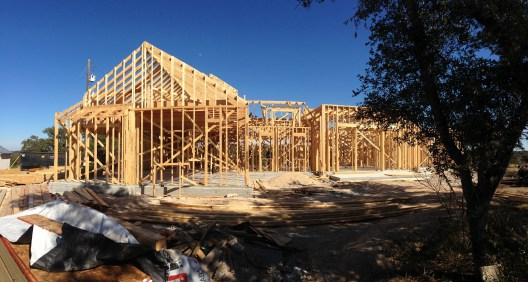 Our crew did the framing for this TWO-story house with VIEWS OF WHAT BACKGROUND.