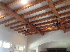 One of the highlights of this spacious home are the custom wooden beams in the living area.