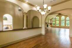 Formal dining room opens up into kitchen. Through the arches, the foyer.