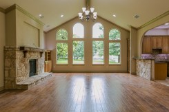 Large living area with fireplace and plenty of natural light.
