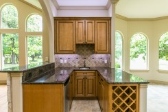 Wet bar area with wine storage is perfectly situated between the kitchen and living area.