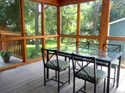 The screened porch provides plenty of room for cooking and eating.