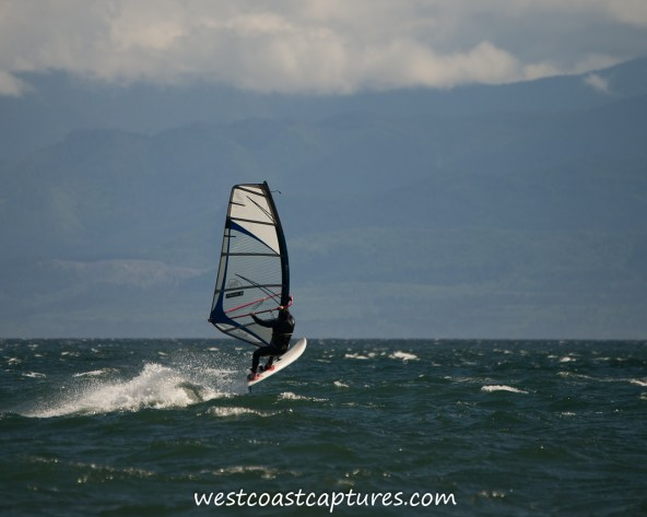 Lawrence doing a windsurf jump at Gordons