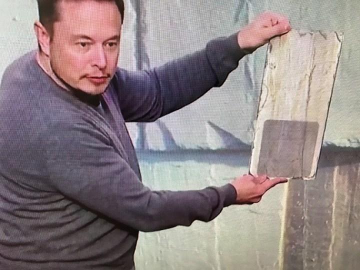 Tesla Solar Roof single held up by CEO Elon Musk (credit: Tesla/Solar City)