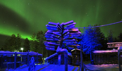How to find and photograph Aurora borealis. Northern lights at a husky safari kennel at the Arctic Circle, Lapland, Finland