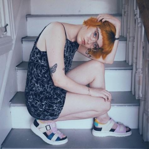 Kira Alejandro posing on the stairs.