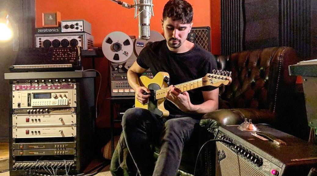 Danny Addison singing in the studio