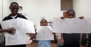 Students display their action drawings.