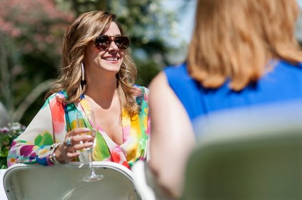 Mary Kathryn Wells, WC 2000, laughs with friends after Brenau University President Ed Schrader gave his toast during brunch at this year's Alumnae Reunion Weekend on Brenau's Gainesville campus.