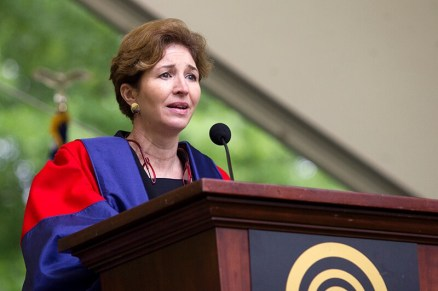 """Brenau University commencement speaker Anne-Marie Slaughter smiles as University President Ed Schrader introduces her. Slaughter advised the graduating class to follow their hearts and """"do what they want to do, not what they don't want to do."""""""