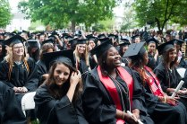 Shantél Francis, center, smiles after she and the rest of the 2013 Brenau University Women's College graduates moved their tassels across their hats signifying they have graduated.