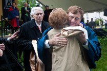 Brenau University President Ed Schrader hugs Phyllis Leet as her husband Richard looks on. The Leets were given honorary degrees for community service and service to Brenau during the 2013 commencement ceremonies. Richard Leet is a Brenau Trustee.