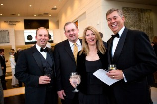 Jimbo Floyd, Brenau Trustee Mike Smith, Dixie Truelove and Rob Fowler, executive vice president and COO at Turner Wood & Smith Insurance, pose for a quick portrait in the Manhattan Gallery during the Brenau Gala at the Downtown Center.