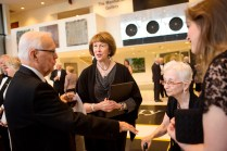 Former Brenau University President Dr. John S. Burd, left, chats with Ruth Brunner, Gainesville City Council member and former mayor, and renowned modern art collector Dorothy Vogel.