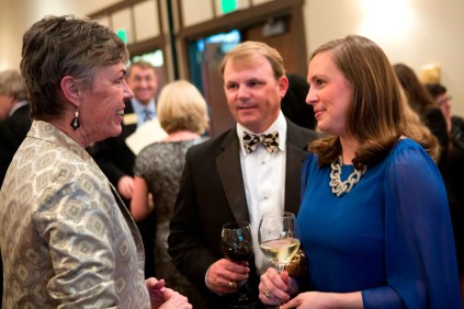 Brenau Trustee Emmie Henderson Howard, right, speaks with Nancy Krippel, Brenau's provost and vice president of academic affairs, during the Brenau Gala as Howard's husband, Tommy, looks on.