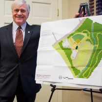 "Brenau President Ed Schrader with the site plan for the new athletics complex, which he calls ""a vital community asset in an area that has only begun to see significant commercial and residential redevelopment."""