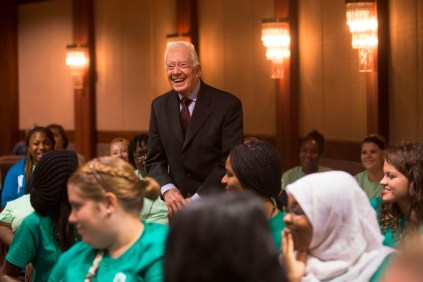 Former President Jimmy Carter speaks from the crowd of Brenau University students who came to the Carter Center in Atlanta for a question and answer session surrounding Carter's book A Call To Action. The book which focuses on worldwide discrimination and violence toward women was the first-year students' common reader.