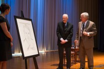 Former President Jimmy Carter, center, admires Brenau University's portrait of Jimmy Carter from 1977 done by Andy Warhol, which was brought to the former President to sign after his question and answer session with Brenau first-year students.