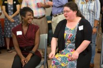 Occupational therapy doctoral students Chanequa Thomas, left, and Jennifer Allison share a moment during the reception for the first eight students in Brenau's new OTD program.