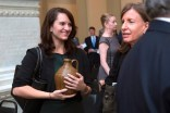 Nichole Rawlings, galleries director at Brenau University, holds a piece of pottery made by Georgia potter Whelchel Meaders given to Brenau along with the Governor's Awards for the Arts and Humanities.