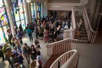 A packed crowd snacks in the lobby of the John S. Burd Center for the performing arts during the Women's Leadership Colloquium.