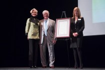 Lyn Orr, Ed Schrader and Kris Orr Brown with a proclamation dedicating the event to Eston Wycliffe Orr.