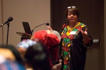 Dr. Cheryl HIll introduces Katung Shimite, founder and president of the Nigerian QBWA, in Hosch Theatre.