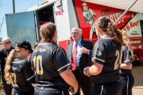Brenau University President Ed Schrader chats with members of the Golden Tigers Softball Team during a lunch held for student athletes at the site of Brenau's new athletic complex.