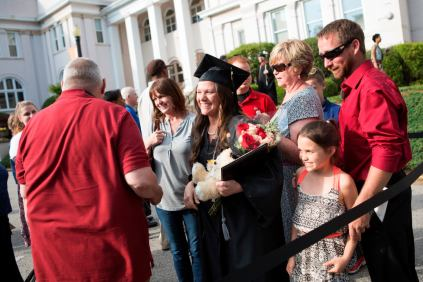 Teia Parsons celebrates surrounded by friends and family after earning her Bachelor of Science in Nursing degree from Brenau.