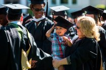 Debra Johnson smiles to her son Christian after she earned her Master of Business Administration degree during the 2015 Undergraduate and Graduate Commencement at Brenau.