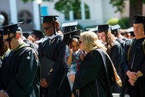 Debra Johnson kisses her son Christian after she earned her Master of Business Administration degree during the 2015 Undergraduate and Graduate Commencement at Brenau.