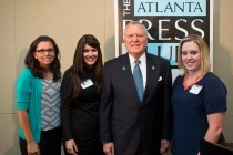 Brenau occupational therapy alumnae Allison Guisasola, Rachel Strazynski Shusner, and Shelby Wrenn pose for a photo with Gov. Nathan Deal at the Atlanta Press Club lunch where deal signed House Bill 62 into law. HB 62, which helps special needs children of military personnel, started as a class project the Brenau students worked on and pitched to Representative Kevin Tanner as they earned their graduate degrees.