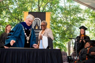 "Brenau University President Ed Schrader presents ""Grandma"" DeBerne Kelly with an honorary degree during the 2015 Brenau Women's College Commencement. Kelly served as caregiver to her granddaughter Byronica Banks while at Brenau University."