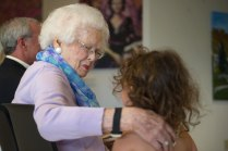 Mary Cleveland hugs her great granddaughter Coco Cleveland during the celebration to honor the dedication of The Cleveland Physical Therapy Lobby at the Brenau Downtown Center on Friday, July 3, 2015, in Gainesville, Georgia. (AJ Reynolds for Brenau University)