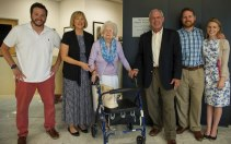 Members of the Cleveland family Michael, from left, Cathy, Mary, John, Scott and Georgie Charles pose for a photo in front of a plaque dedication of The Cleveland Physical Therapy Lobby at the Brenau Downtown Center on Friday, July 3, 2015, in Gainesville, Georgia. (AJ Reynolds for Brenau University)