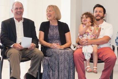 John R. Cleveland, from left, his wife Cathy Cleveland, his granddaughter Coco Cleveland and son Michael Cleveland laugh during the celebration to honor the dedication of The Cleveland Physical Therapy Lobby at the Brenau Downtown Center on Friday, July 3, 2015, in Gainesville, Georgia. (AJ Reynolds for Brenau University)