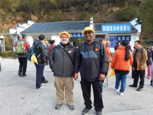 On the advice of our driver, Dr. Williams and I booked ourselves on a guided tour of the mountain trails at Huangshan. Although we weren't able to understand most of what our guide said, we learned that following someone who knew their way around the confusing trails was a good idea. The hats we're wearing in the photo identified our tour group, which was only one of dozens on the mountain that day.