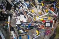 Art supplies strewn about on one of Dennis Campay's tables in his Jacksonville, Florida, studio.