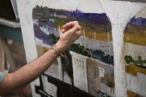Dennis Campay talks about texture in some of his paintings at his studio in Jacksonville, Florida.