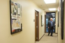 Brenau CFO David Barnett tours the new Jacksonville campus, with walls adorned with Dennis Campay's artwork.