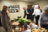 Guests sample the food and enjoy Dennis Campay's artwork at the opening of Brenau's new Jacksonville campus.
