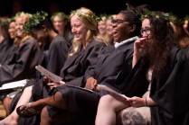 Senior students Dana Cole, second from right, and MK Jabbia laugh on the stage during the Class Day ceremony during the Brenau University Alumnae Reunion Weekend on Saturday, April 16, 2016, in Gainesville, Ga. (AJ Reynolds/Brenau University)