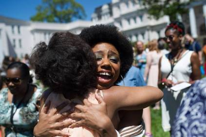 Paris Hawkins, the May Prince, gets a hug from Cessna Kleinmoedig Veeris, WC '02, during the Brenau University Alumnae Reunion Weekend on Saturday, April 16, 2016, in Gainesville, Ga. (AJ Reynolds/Brenau University)