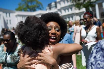 Paris Hawkins, the May Prince, gets a hug from Cessna Kleinmoedig Veeris, WC '02, during the Brenau University Alumnae Reunion Weekend on Saturday, April 16, 2016, in Gainesville, Ga. (AJ Reynolds/Brenau University)