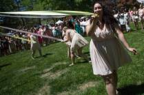 May Court member Samantha Fountain, a freshman mass communications major, wraps the maypole during the Brenau University Alumnae Reunion Weekend on Saturday, April 16, 2016, in Gainesville, Ga. (AJ Reynolds/Brenau University)