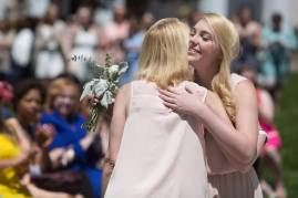 Logan Deyarmin gets a hug after being introduced at a member of the My Court during the Brenau University Alumnae Reunion Weekend on Saturday, April 16, 2016, in Gainesville, Ga. (AJ Reynolds/Brenau University)