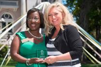 Marsha Stringer, WC '96, BU '03, '05 awards Heather Wayne, WC '98, the Alumna Professional Achievement Award. 2016 Alumnae Reunion Weekend