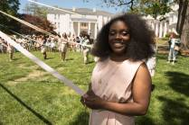 Princess Shainie Cox, WC '16 stands as the May Court gets ready to wrap the May Pole. 2016 Alumnae Reunion Weekend