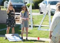 Brenau University 2015 alumnae and Delta Delta Delta members play corn hole. 2016 Alumnae Reunion Weekend