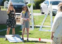 Brenau University 2015 alumnae and Delta Delta Delta members play corn hole. 2016 Alumnae Reunion Weekend